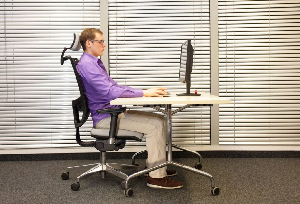 Young Male Sitting in Correct Posture While Working