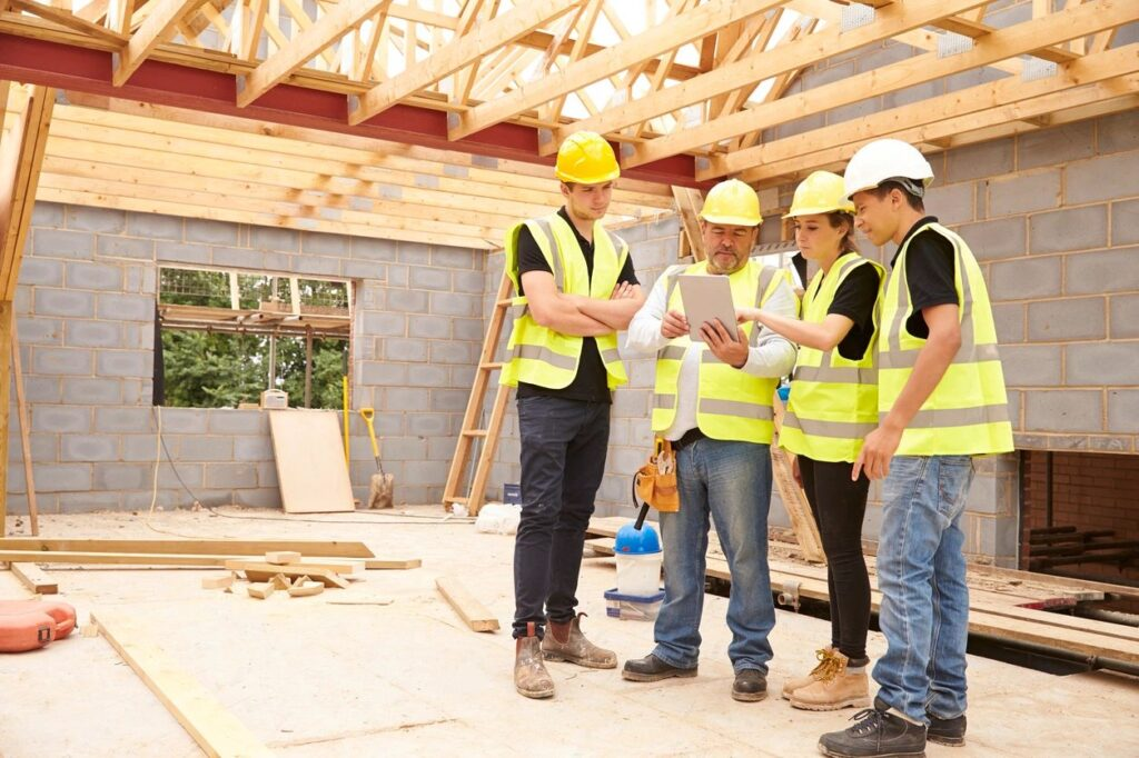 Construction workers Discussing Building Plan