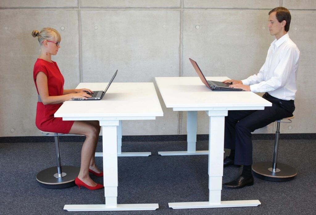Two Business Workers Sitting in Proper Posture