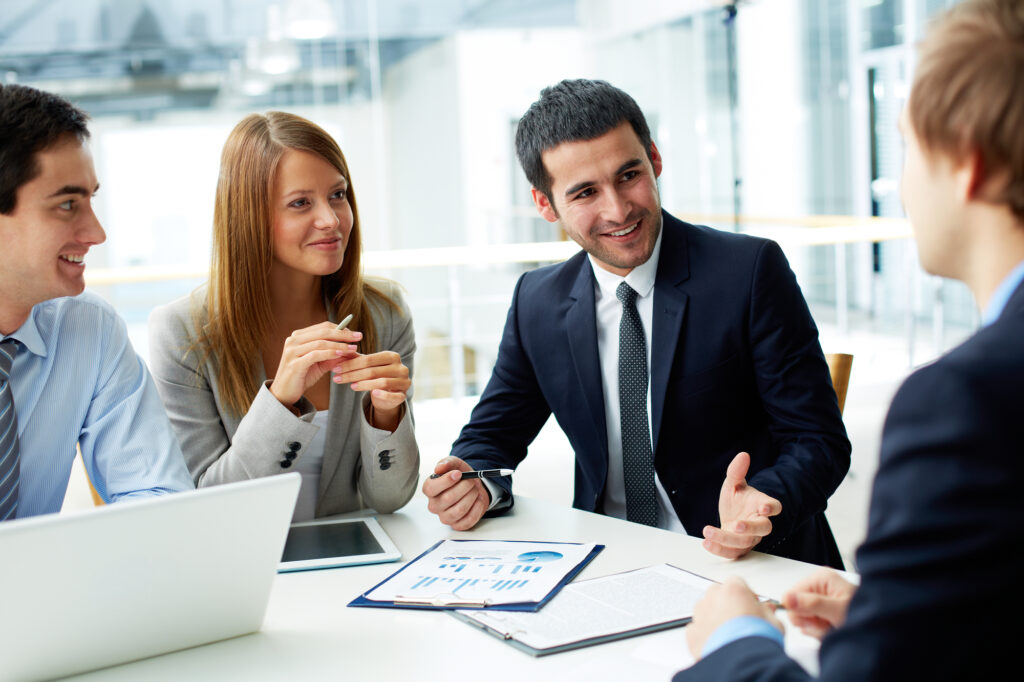 Business Partners Discussing Documents and Ideas at a Meeting
